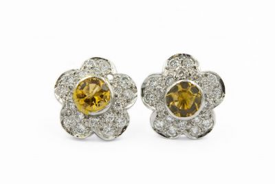 Contemporary Platinum Diamond and Topaz Flower Earrings
