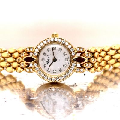 Ladies Contemporary 18K Yellow Gold Diamond and Ruby Wristwatch By Chopard 35.0dwt